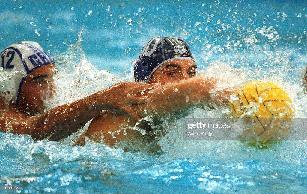 A.Calcaterra of Italy goes for a backhand shot defended by K. Dandolos of Greece, during the Italy vs Greece preliminary match of the Waterpolo World Cup at the Sydney International Aquatic Centre, Homebush Sydney, Australia. Mandatory Credit: Adam Pretty/ALLSPORT