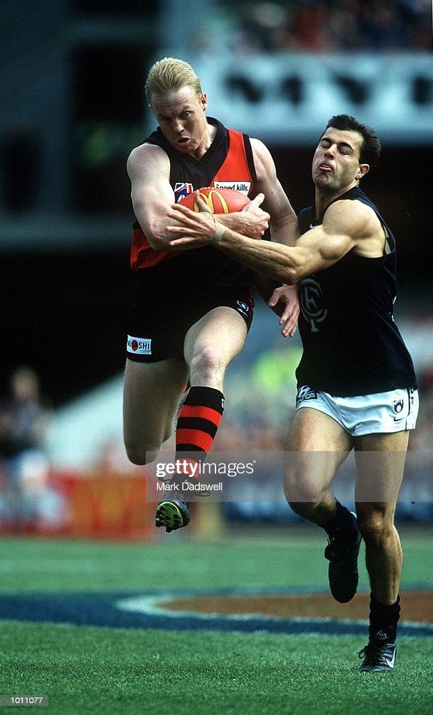 Ben Nelson #15 for the Carlton Football Club, tackles Paul Barnard #16 for the Essendon Football Club during the 2nd Preliminary final , at the MCG, Melbourne, Victoria, Australia. Carlton advanced to the grand final by defeating Essendonby one point. Mandatory Credit: Mark Dadswell/ALLSPORT