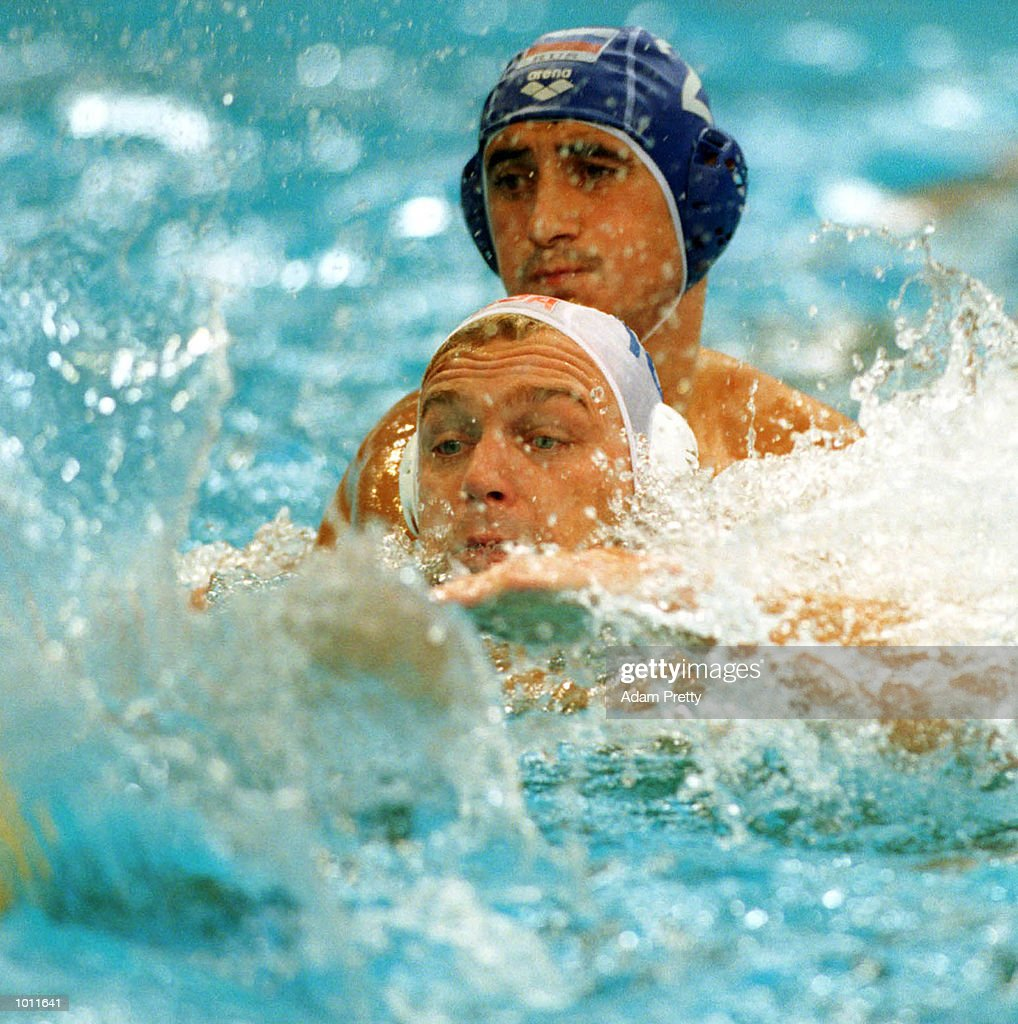 Chris Humbert of USA is chased by Alexei Panfili of Russia during the match between USA v Russia in the Waterpolo World Cup at the Sydney International Aquatic Centre, Homebush Sydney, Australia. Mandatory Credit: Adam Pretty/ALLSPORT