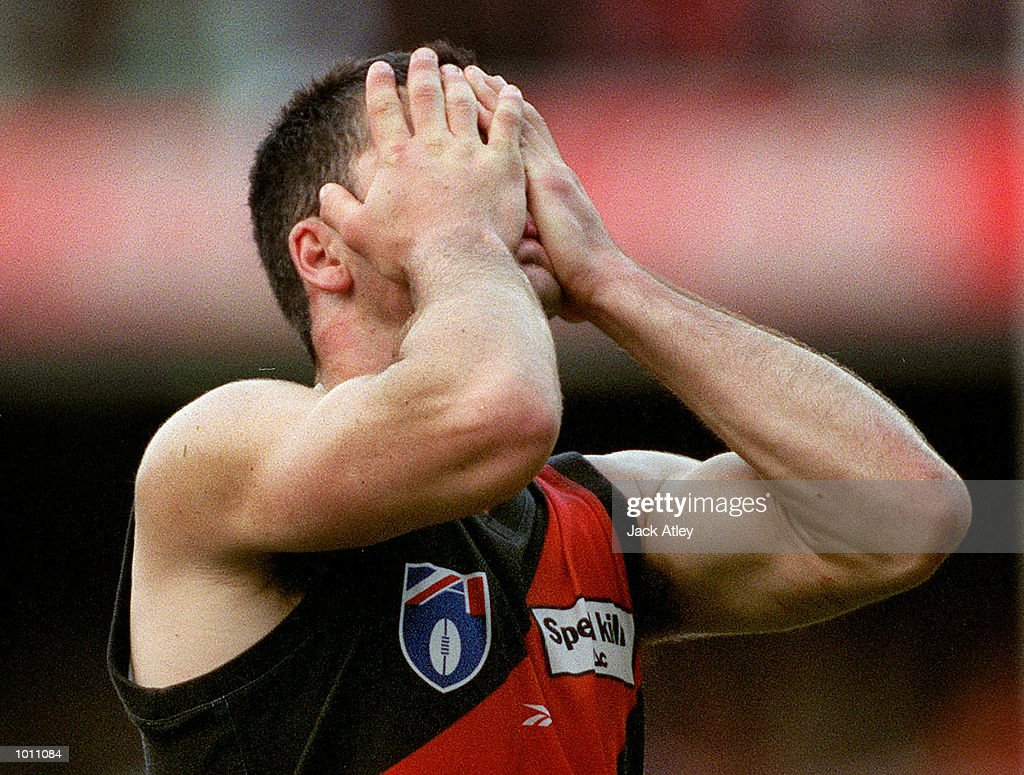 Dean Solomon #7 for the Essendon Bombers leaves the ground in anguish after his side was defeated by the Carlton Blues by one point in the 2nd Preliminary final at the Melbourne Cricket Ground, Melbourne, Australia. Carlton advanced to the Australian Football League Grand Final next week after defeating Essendon by one point. Mandatory Credit: Jack Atley/ALLSPORT