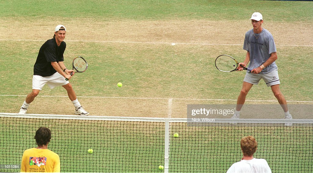 Lleyton Hewitt and Wayne Arthurs of Australia volley against their Davis Cup teamates Mark Woodforde and Sandon Stolle at training before the Davis Cup Semi Final against Russia starting Friday at ANZ Stadium,Brisbane,Australia. MandatoryCredit: Nick Wilson/ALLSPORT