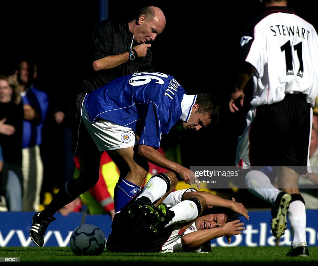 Leicester defender Lee Marshall has strong words for Ipswich player Martijn Reuser(floor) before being sent off. during todays Barclaycard Premiership Game between Leicester City and Ipswich Town at Filbert Street, Leicester. DIGITAL IMAGE. Mandatory Credit: Stu Forster/ALLSPORT