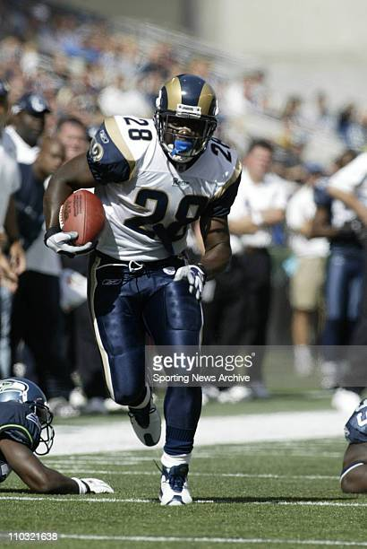 Marshall Faulk of the St Louis Rams during the Rams 2423 loss to the Seattle Seahawks at Seahawks Stadium in Seattle WA