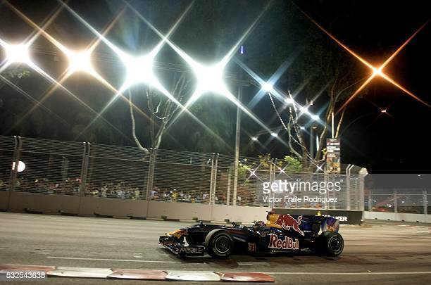 Sept 2009, Singapore --- Red Bull Racing driver Mark Webber of Australia steers his car during second practice session at the Marina Bay street...