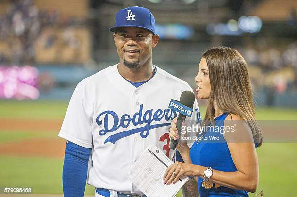 Los Angeles Dodgers Left field Carl Crawford [3116] is interviewed by SportsNet LA reporter Alanna Rizzo after the Major League Baseball game between...
