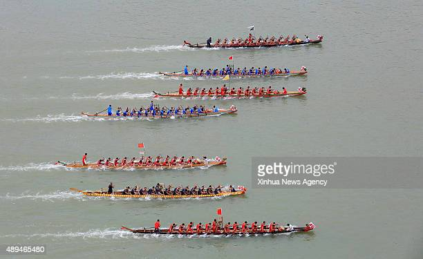 LIUZHOU Sept 21 2015 Dragon boats compete in aracing competition in Rong'an County of Liuzhou City south China's Guangxi Zhuang Autonomous Region...