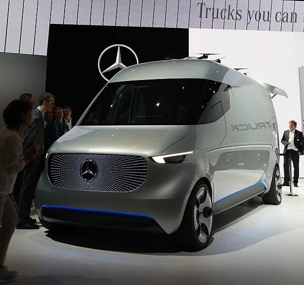 People visit a Mercedes-Benz Vision Van at the Mercedes-Benz ...