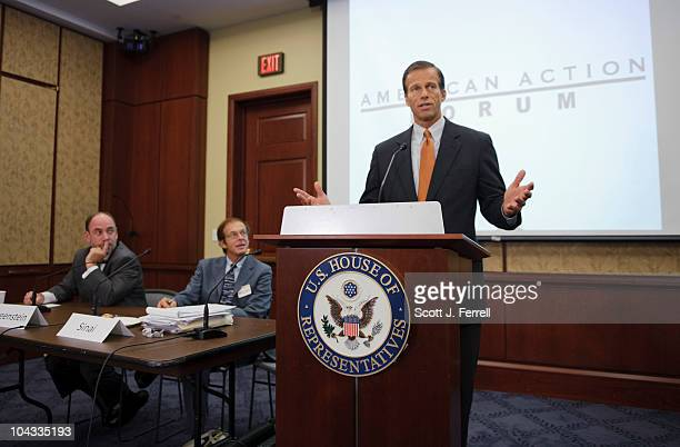 Sen John Thune RSD speaks during an American Action Forum at the US Capitol on the financial crisis in the US Looking on are Douglas HoltzEakin of...