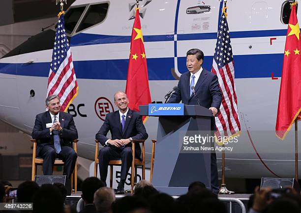 Chinese President Xi Jinping right addresses a welcome ceremony held by Boeing Company during his visit to Boeing Commercial Airplanes in Everett of...
