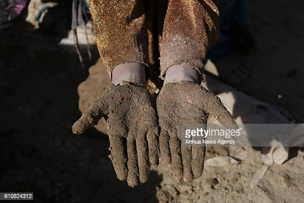 KABUL Sept 26 2016 An Afghan child shows her dirty hands at a brick factory in Kabul capital of Afghanistan Sept 26 2016 Some 13 million schoolaged...
