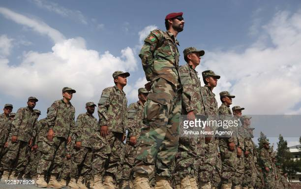 Sept. 27, 2020 -- Afghan Army soldiers take part in their graduation ceremony at Kabul Military Training Center in Kabul, capital of Afghanistan,...