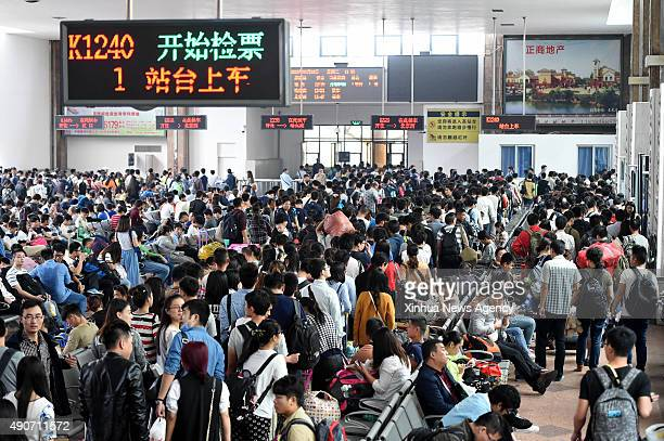 Sept. 30, 2015 -- Passengers are seen at the waiting room of a railway station in Zhengzhou, central China's Henan Province, Sept. 30, 2015. Railway...