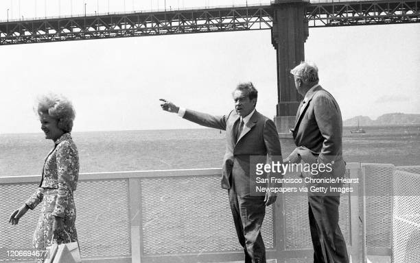 President Richard Nixon and his wife Pat brave the winds on board a ferry boat in San Francisco Bay where he was lobbying to create the Golden Gate...