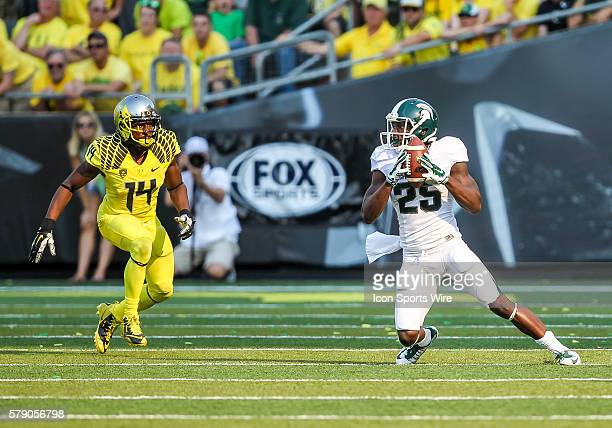 Michigan State Spartans wide receiver Keith Mumphery makes a catch in front of the defense of Oregon Ducks defensive back Ifo EkpreOlomu during the...