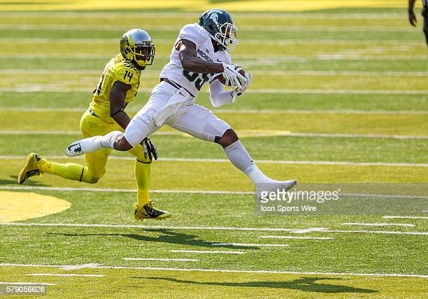 Michigan State Spartans wide receiver Macgarrett Kings Jr makes a catch in front of Oregon Ducks defensive back Ifo EkpreOlomu during the game...