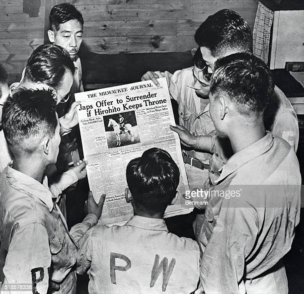 Sept1945Camp McCoy WIS Japanese prisoners of war read newspaper announcing impending surrender of Japan This is first photo showing Japanese PW's in...