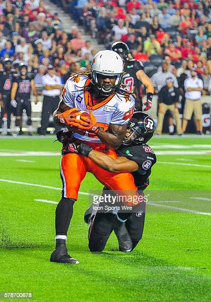Jermaine Robinson tackles Courtney Taylor looks to throw the ball during the Ottawa RedBlacks game versus the BC Lions at TD Place Stadium in Ottawa,...