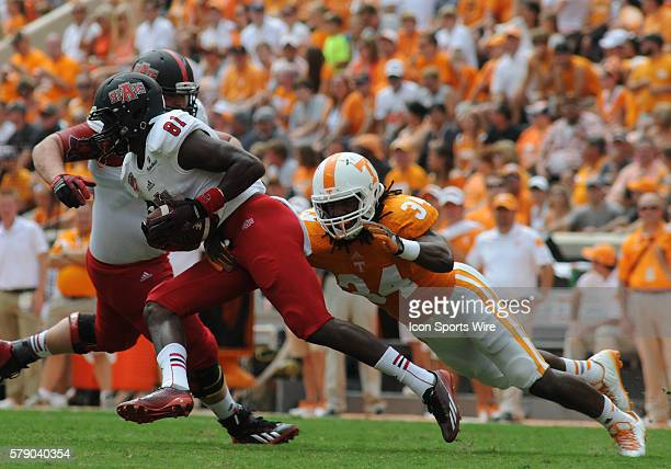 Carl Lee Jr. Arkansas State Red Wolves wide receiver attempts to allude the tackle of Jalen Reeves-Maybin Tennessee Volunteers linebacker during the...