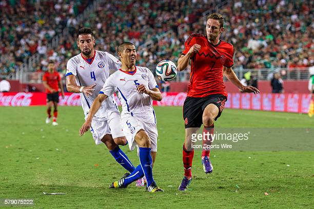 Chile midfielder Francisco Silva clears the ball past Mexican defender Miguel Layun during the game between Mexico and Chile at Levi's Stadium in...
