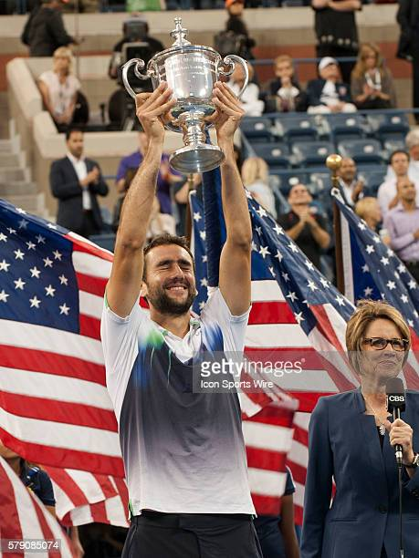 Marin Cilic of Croatia posing with trophy after defeating Kei Nishikori of Japan and winning the Men's Singles Championship title at the US Open...