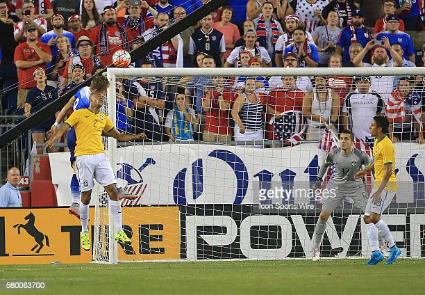 Jordan Morris of the USAMNT goes up for a header with Fabinho of Brazil during an international friendly match at Gillette Stadium in Foxborough MA...