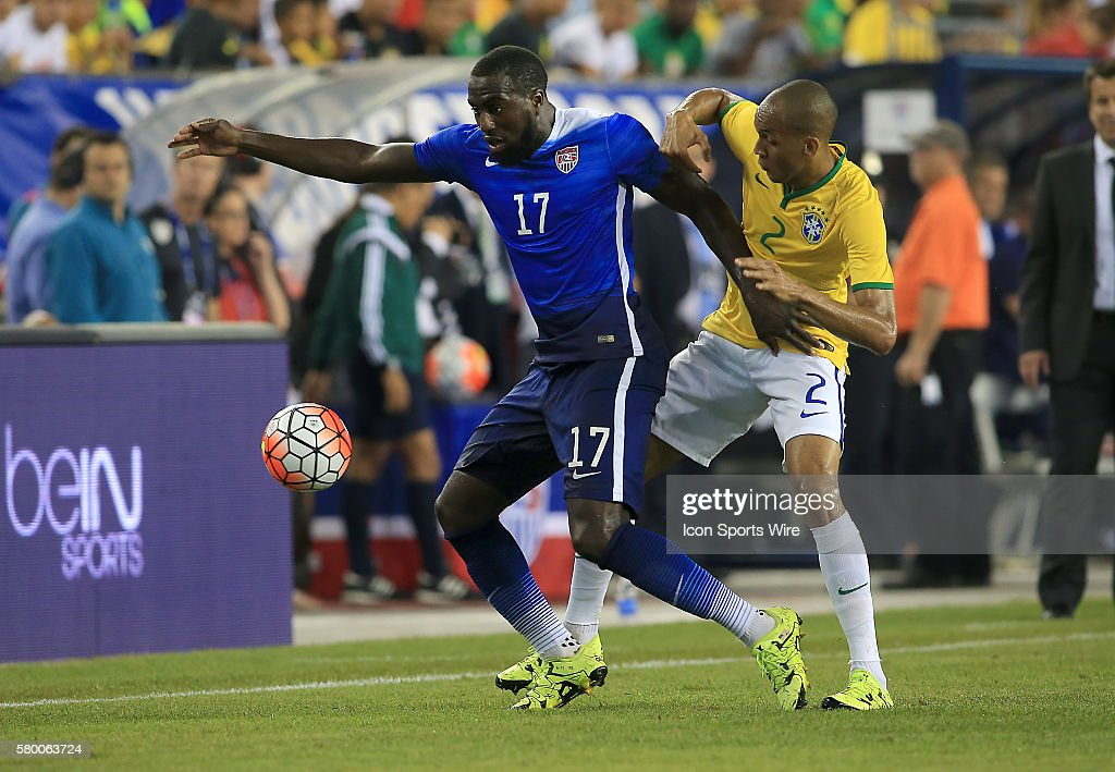 Jozy Altidore (17) of the USAMNT is held up by Fabinho (2) of Brazil during an international friendly match at Gillette Stadium, in Foxborough, MA. Brazil won 4-1.