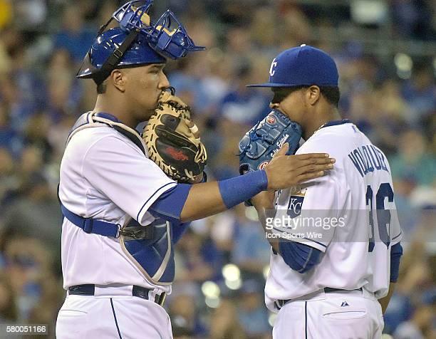 Kansas City Royals' catcher Salvador Perez talks to Kansas City Royals' starting pitcher Edinson Volquez during an MLB game between the Minnesota...
