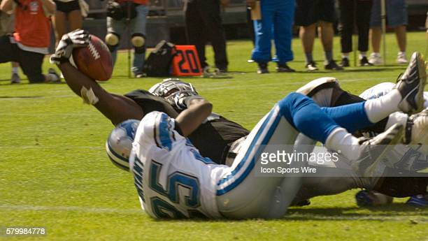 Oakland Raiders running back LaMont Jordan makes TD with Detroit Lions cornerback Fernando Bryant in close contact on Sunday September 09 2007 at...
