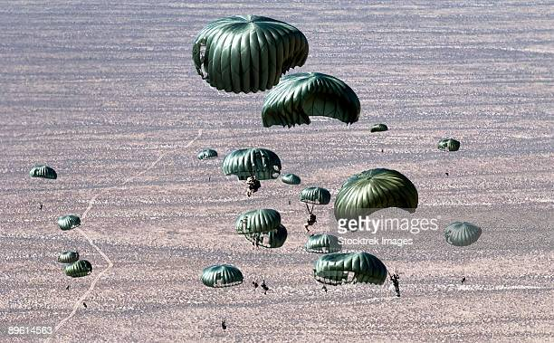 september 1, 2006 - pararescuemen jump out of a c-130 hercules over the nevada test and training ranges in support of red flag exercise 06-2.  - paratrooper stock pictures, royalty-free photos & images
