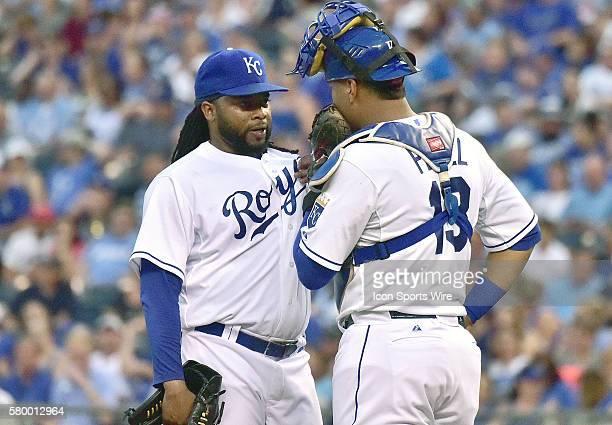 Kansas City Royals' catcher Salvador Perez talks with Kansas City Royals' starting pitcher Johnny Cueto during a Major League Baseball game between...