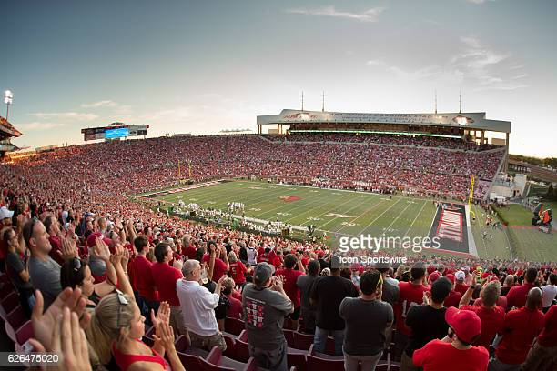 Louisville Cardinal fans cheer during the 1st half of the NCAA football game between the Louisville Cardinals and the Charlotte 49ers at Papa John's...