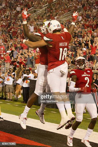 Louisville tight end Cole Hikutini celebrates a touchdown during the 2nd half of the NCAA football game between the Louisville Cardinals and the...