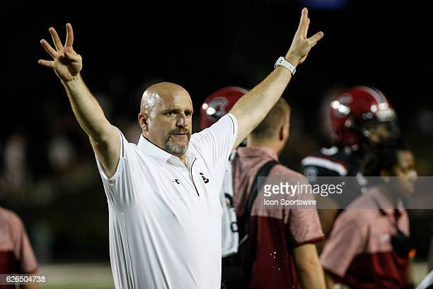 South Carolina strength and conditioning coach Jeff Dilliman raises four fingers heading into the fourth quarter as South Carolina took on...