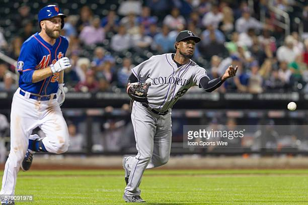 Colorado Rockies Pitcher Yohan Flande [7489] throws out New York Mets Infield Eric Campbell [8068] on a soft comebacker to the mound during the...