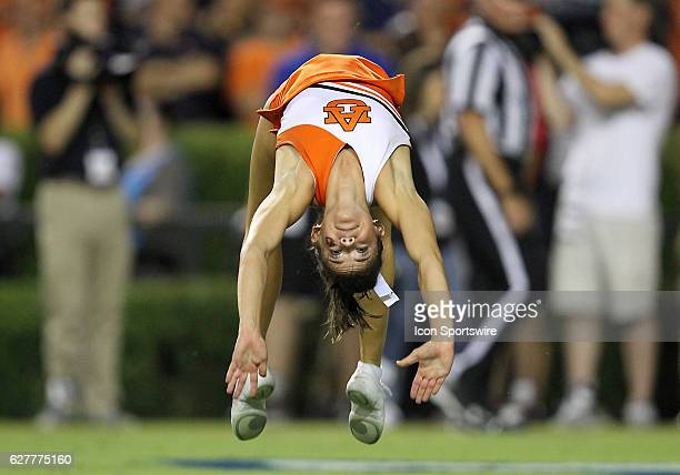 An Auburn Tigers cheerleader turns flips during an NCAA football game between the Auburn Tigers and the Arkansas State Red Wolves at Jordan Hare...