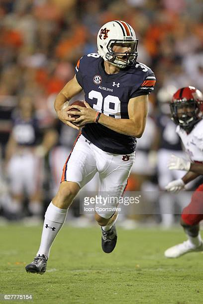 Auburn Tigers place kicker Daniel Carlson takes the ball on a fake field goal attempt and runs for a touchdown during an NCAA football game between...