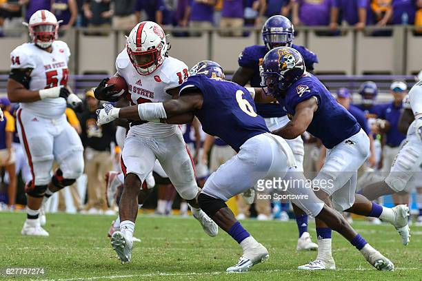 September 10 2016 East Carolina Pirates defensive back DaShawn Benton tackles North Carolina State Wolfpack wide receiver Bra'Lon Cherry as time runs...