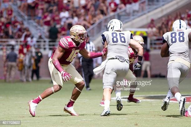 Florida State LB Jacob Pugh attempts to make a tackle on Charleston Southern TE Stephen Cagle during the game between the Florida State Seminoles and...