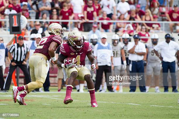Florida State RB Dalvin Cook jump cuts as her runs the ball during the game between the Florida State Seminoles and the Charleston Southern...
