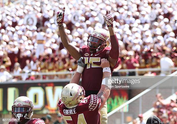 Florida State WR Travis Rudolph is lifted in the air by Florida State OL Alec Eberle after scoring a touchdownduring the game between the Florida...