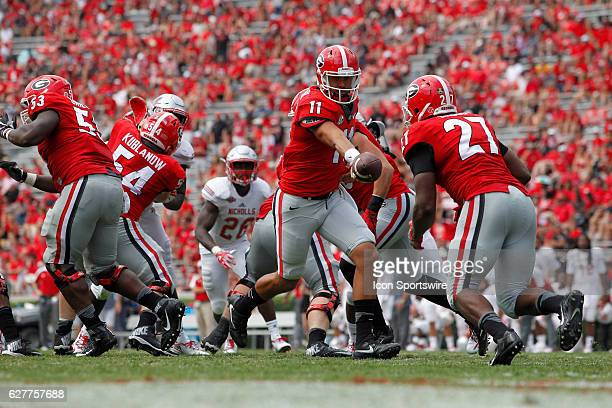 Georgia Bulldogs quarterback Greyson Lambert hands the ball off to Georgia Bulldogs running back Nick Chubb late in the fourth quarter The Georgia...