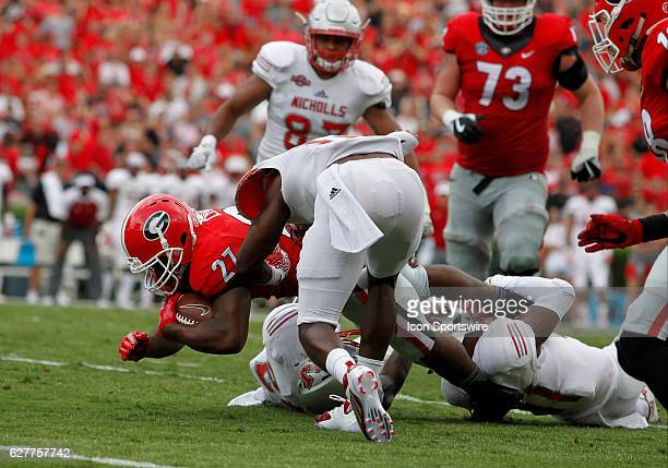 Georgia Bulldogs running back Nick Chubb dives for extra yards in the fourth quarter The Georgia Bulldogs defeated the Nicholls State Colonels 26 24...