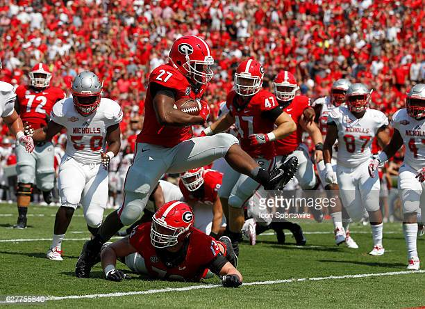 Georgia Bulldogs running back Nick Chubb high steps into the end zone for a first half touchdown at Samford stadium in Athens Georgia