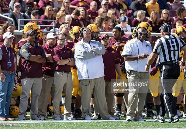 Minnesota Gophers head coach Tracy Claeys is not happy with the referees former head coach Jerry Kill looks on from the sidelines during the...