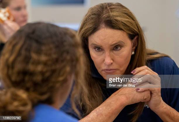 September 11,2021: Republican gubernatorial candidate Caitlyn Jenner talks with young woman while touring the Los Angeles Dream Center on Saturday,...