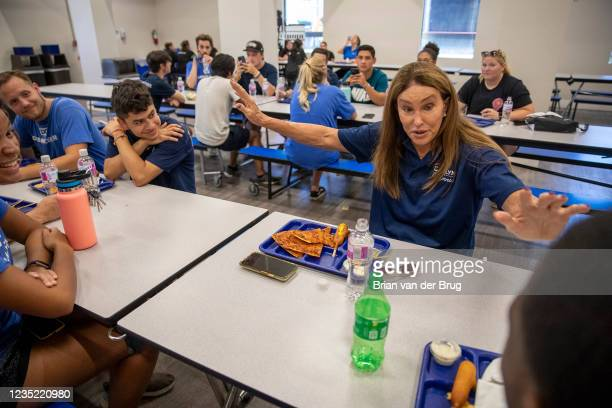 September 11,2021: Republican gubernatorial candidate Caitlyn Jenner, right, talks with young people while touring the Los Angeles Dream Center on...