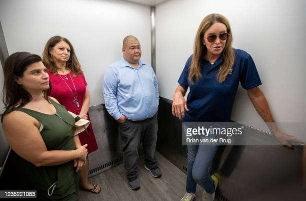September 11,2021: Republican gubernatorial candidate Caitlyn Jenner, right, talks with campaign staff in an elevator while touring the Los Angeles...
