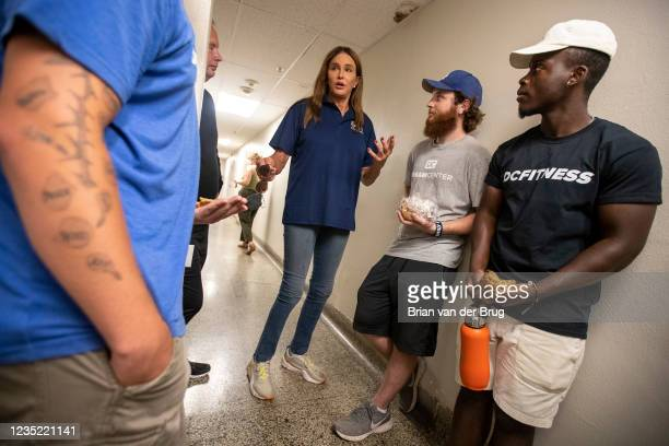 September 11,2021: Republican gubernatorial candidate Caitlyn Jenner, center, talks with young people while touring the Los Angeles Dream Center on...