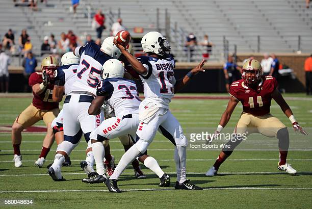Howard University quarterback Kalen Johnson tosses a pass watched by Boston College defensive end Wyatt Ray . The Boston College Eagles defeated the...