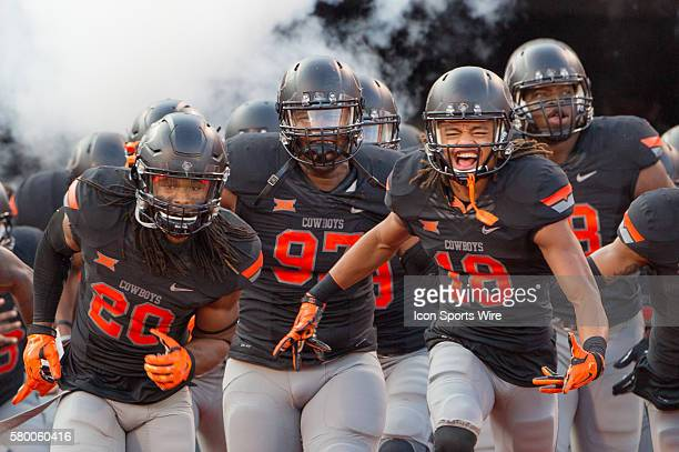 Oklahoma State Cowboys taking the field during the NCAA Division One football game between the Central Arkansas Bears and the Oklahoma State Cowboys...
